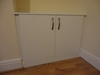 Bespoke cabinet made to fit in dining room alcove